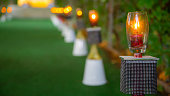 Candle sticks on wedding entryway with crafts