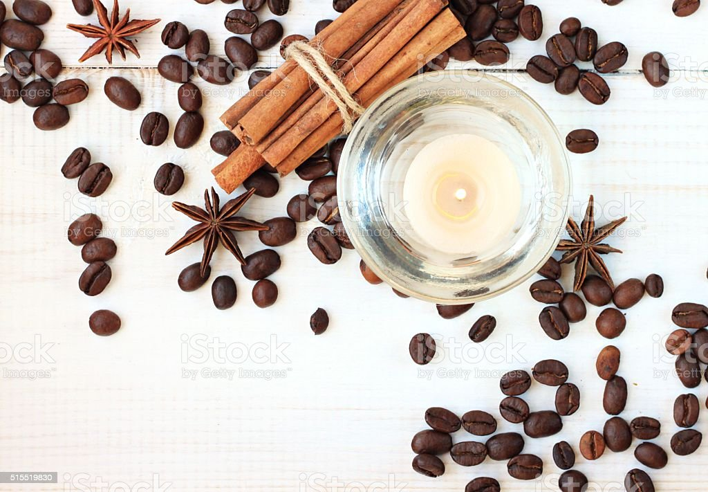 Candle with coffee and cinnamon scent stock photo