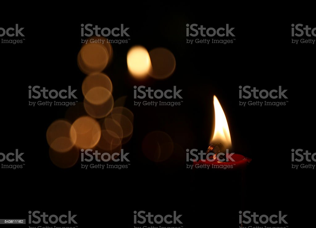 Candle with Flame on Black Background stock photo