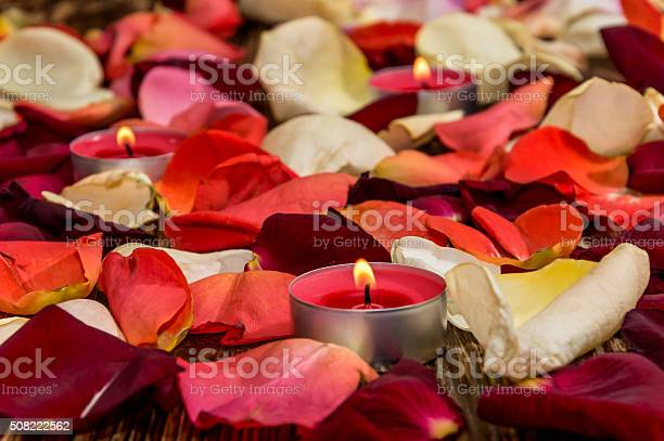 Candle with rose petals on wooden background picture id508222562?b=1&k=6&m=508222562&s=612x612&h=gl 6t 2homvmsdjhmca1sducinrnd8pboxdkvqjh5ua=
