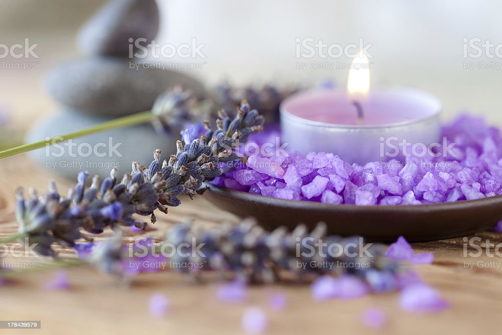 Candle with salt baths and sprigs of lavender stock photo
