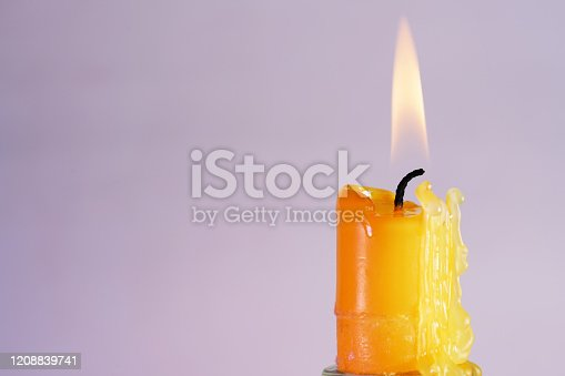 This is a candle with smoke and flame photographed in the studio with color foils before the flashes