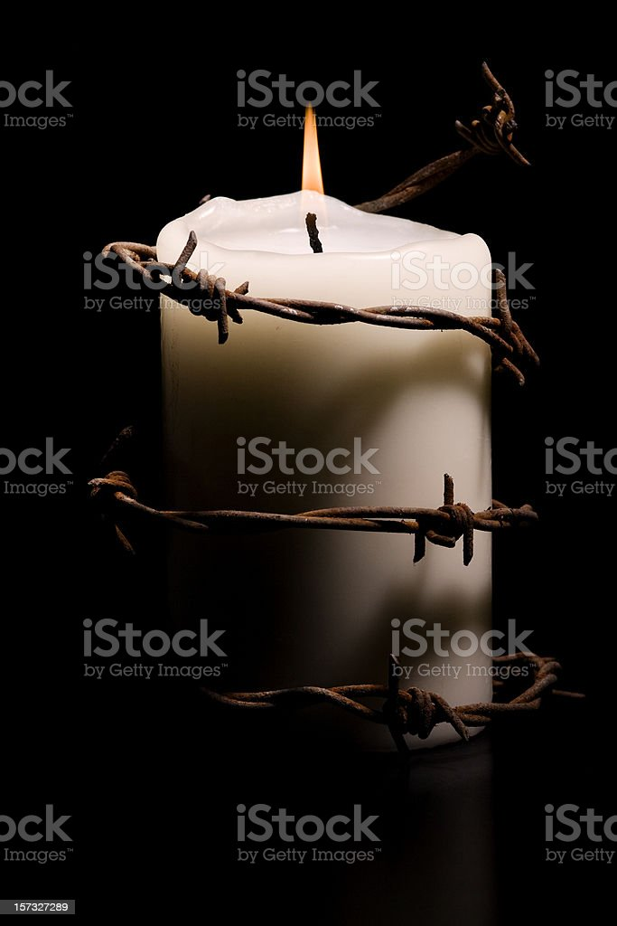 candle wrapped with barbed wire - Royalty-free Amnesty International Stock Photo