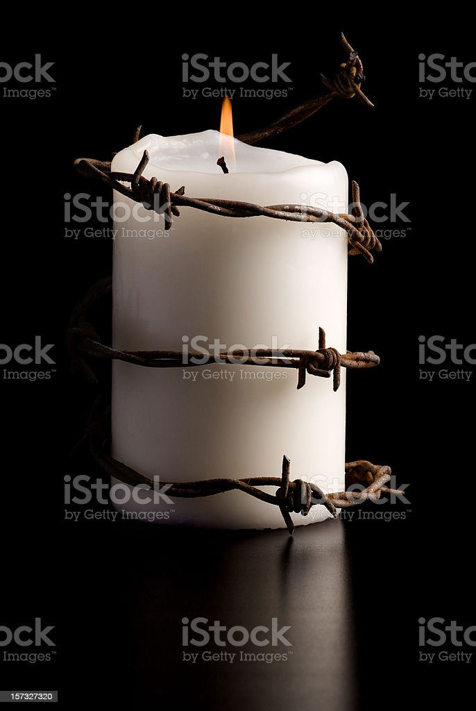 candle wrapped with barbed wire royalty-free stock photo