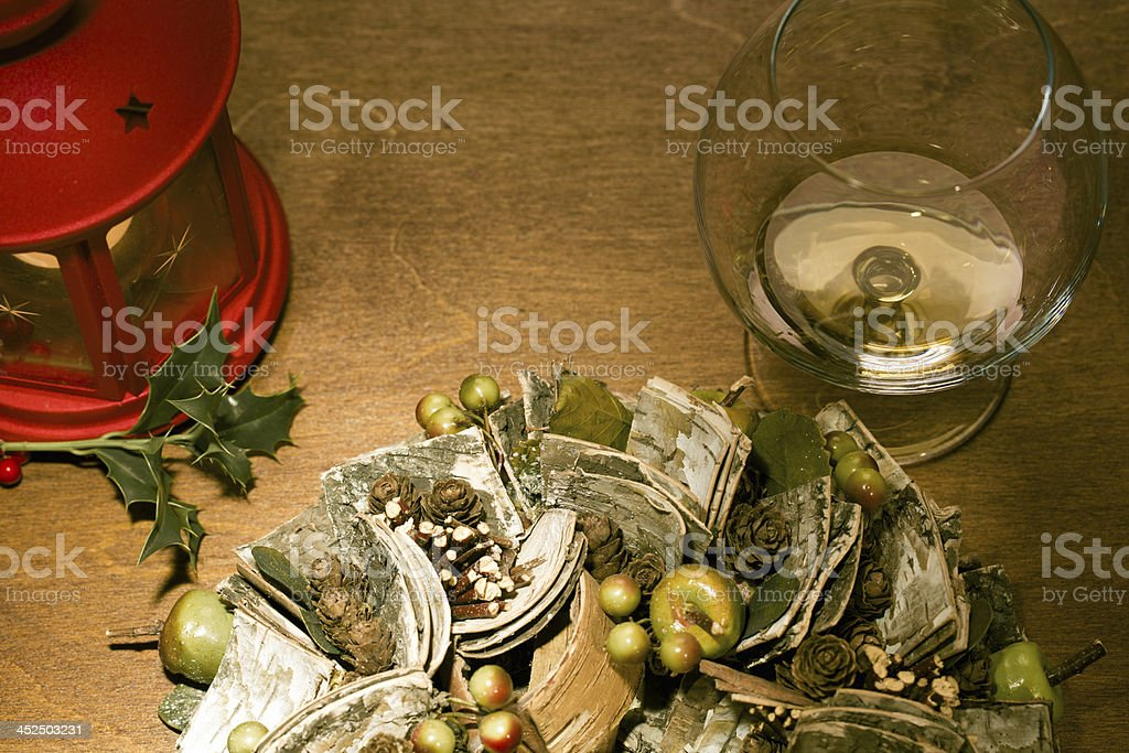 candle, wreath and cognac in glass royalty-free stock photo