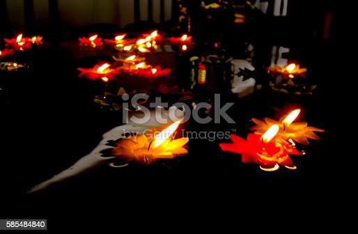 155139080istockphoto Candlelight Candles flower floating on a water. 585484840