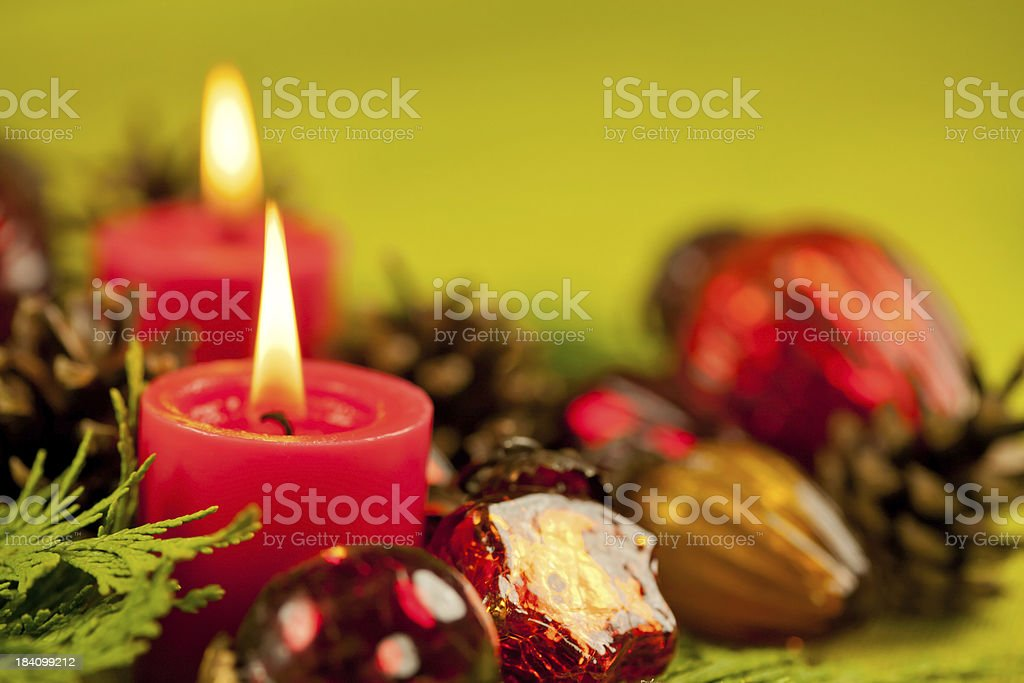 Candlelight Christmas decoration and green fabric background stock photo