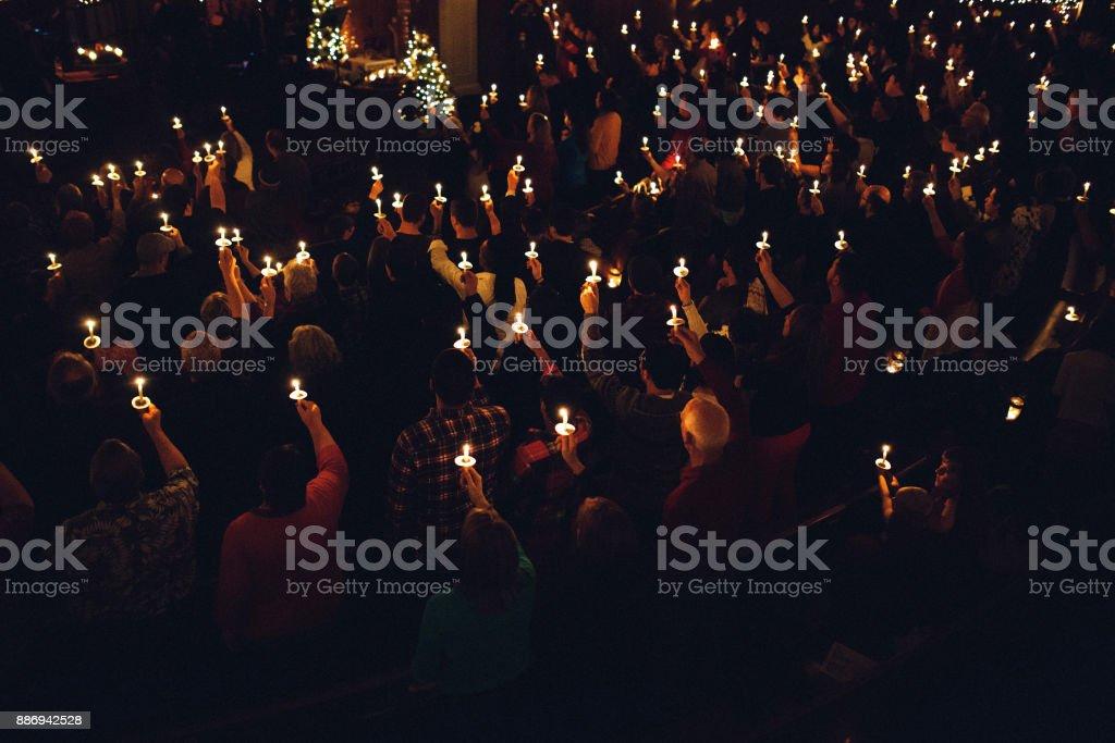 Candlelight Church Service on Christmas Eve stock photo
