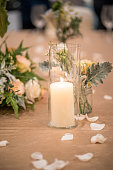 Candlelight decoration on top of wedding reception table