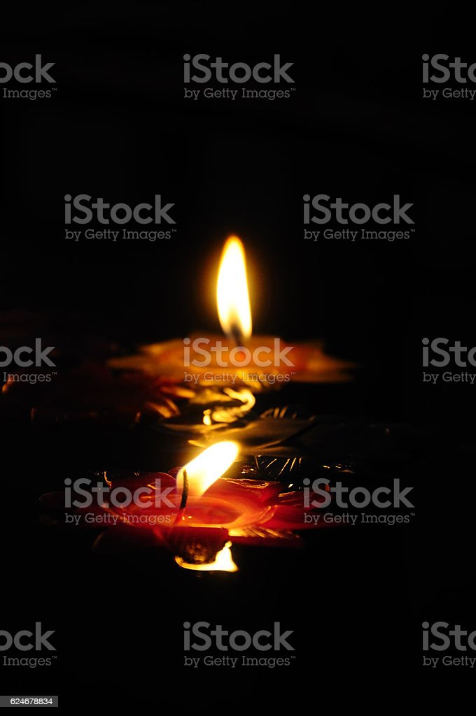 Candlelight floating on water stock photo
