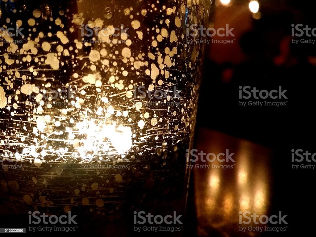 Candlelight in a glass cup stock photo