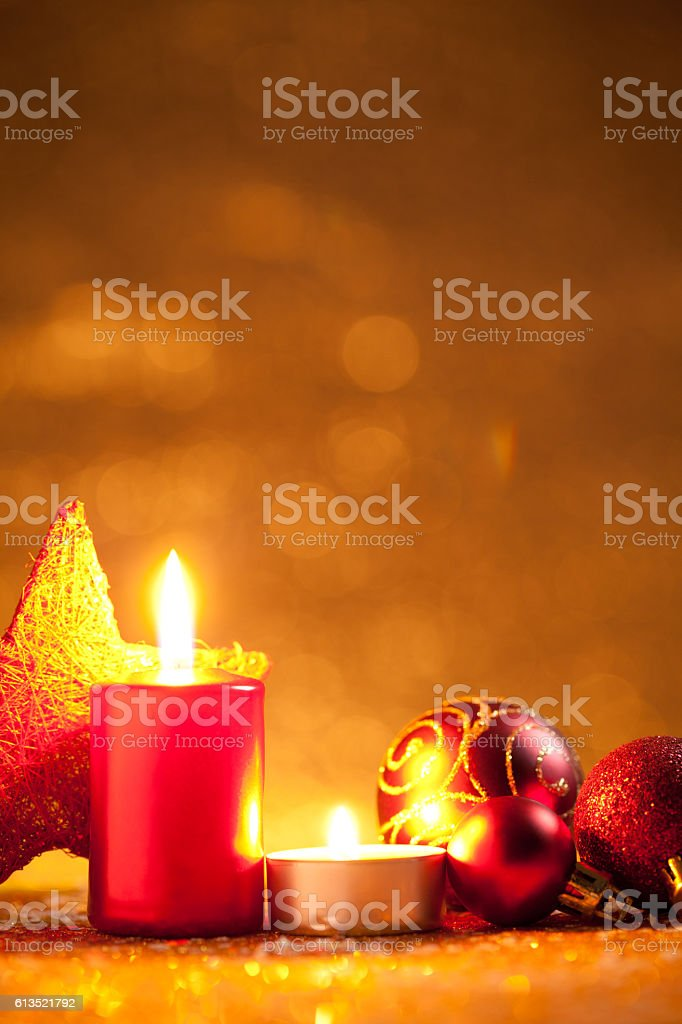 Candles and baubles on glitter with gold background stock photo