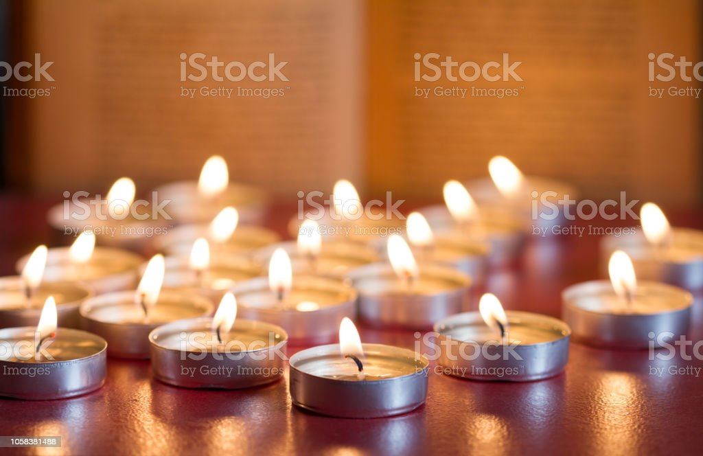 Candles and bible religion abstract christmas background stock photo