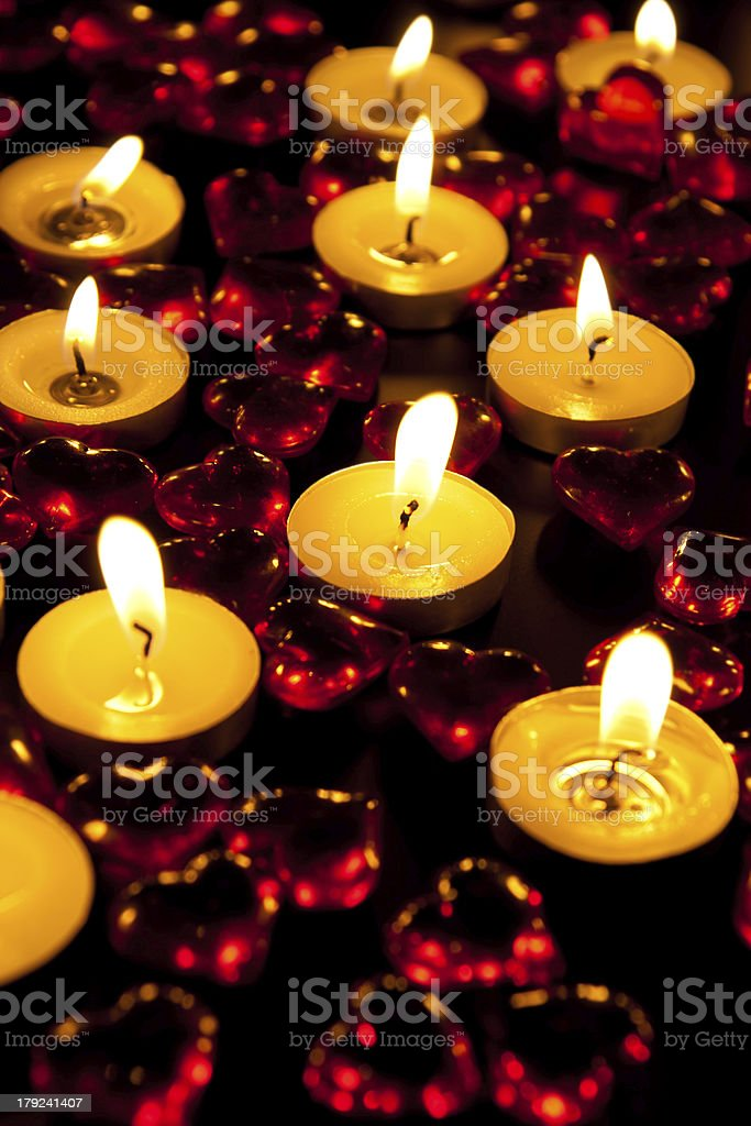 Candles and decorative red heart royalty-free stock photo