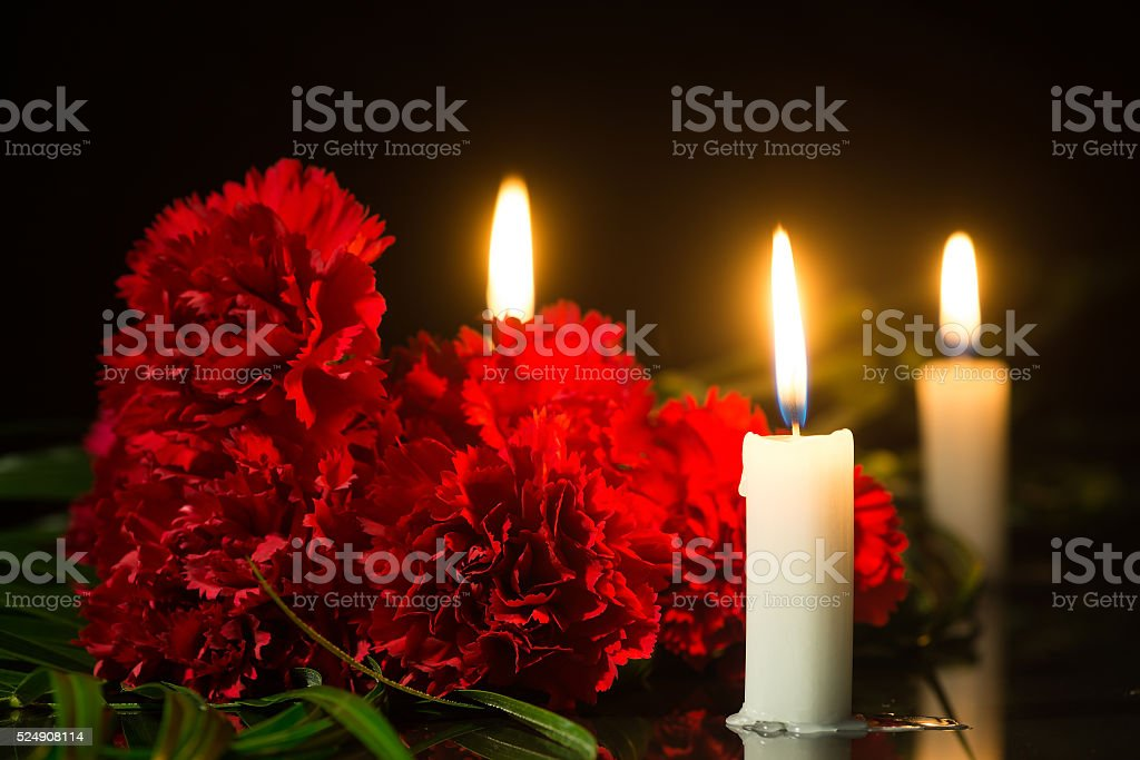candles and red flowers stock photo