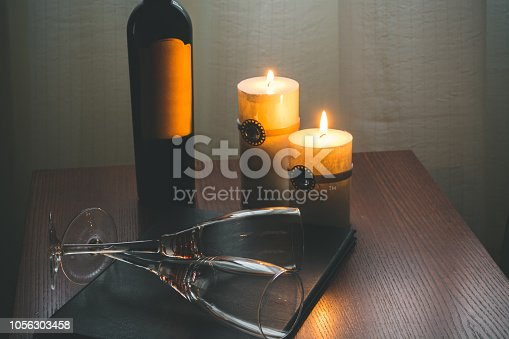 istock Candles and wine in hotel room 1056303458