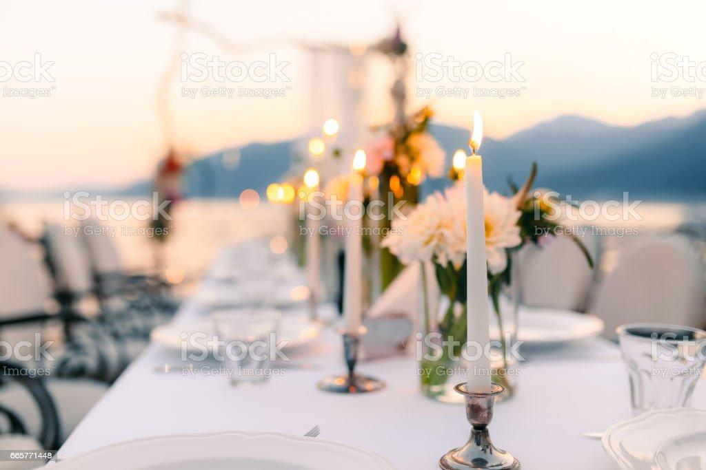Candles at the wedding banquet. Wedding decorations. Wedding at stock photo