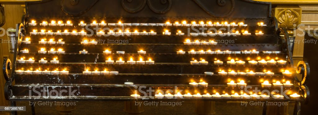 Candles burn in the Christian church stock photo