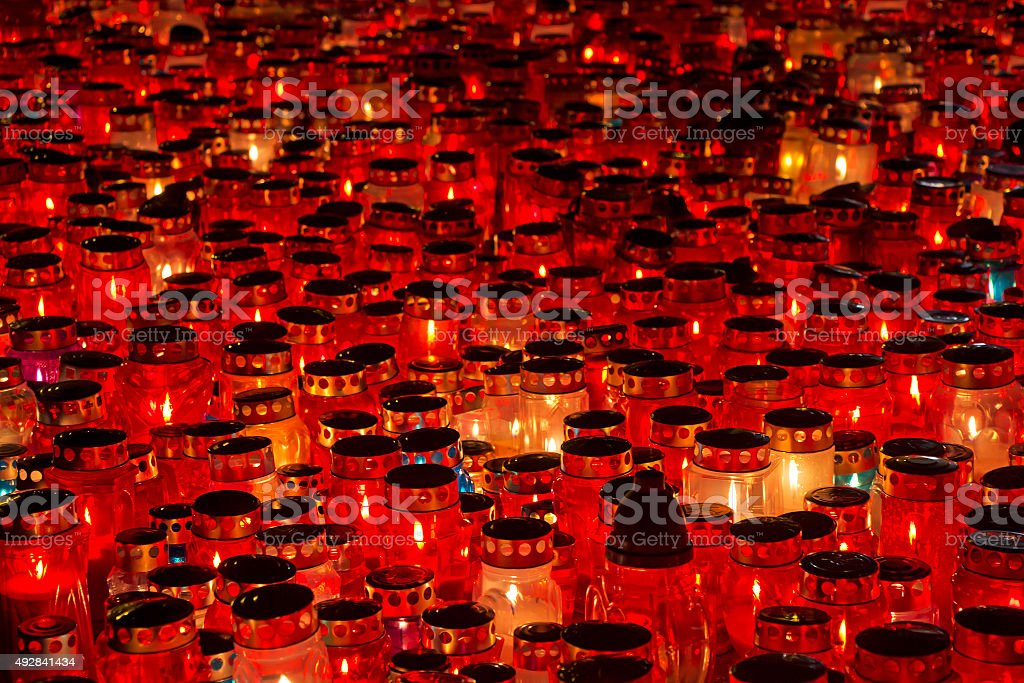 Candles Burning At a Cemetery stock photo