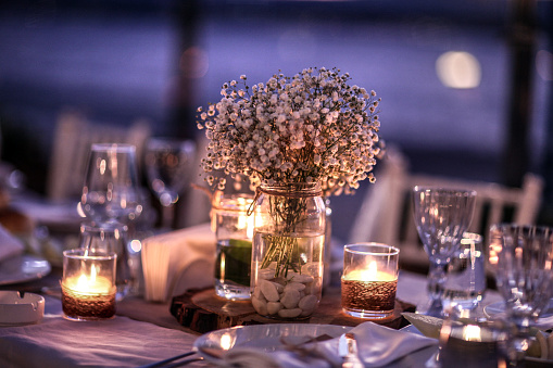 Candles burning in place setting