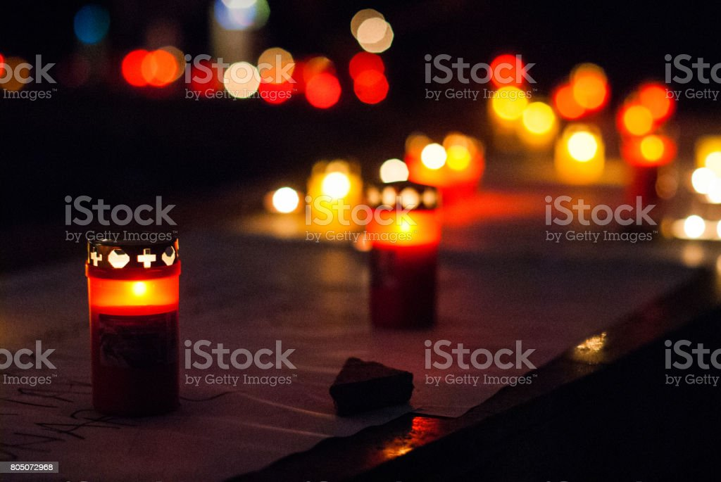 Candles burning in the night. stock photo