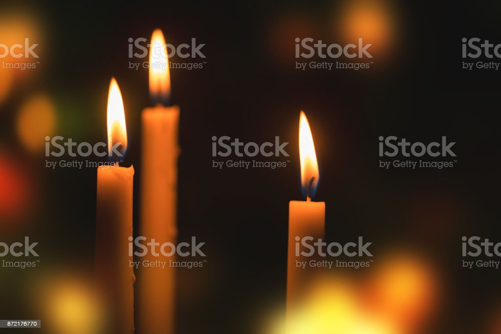 Candles burning in the night stock photo