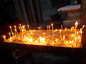 Candles burning in an old church