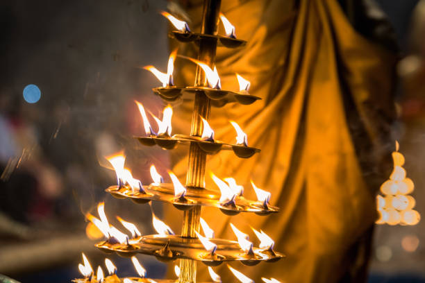 Candles fire puja Candles used in performance of religious Ganga Aarti ritual fire puja at Dashashwamedh Ghat in Varanasi, Uttar Pradesh, India. dashashwamedh ghat stock pictures, royalty-free photos & images