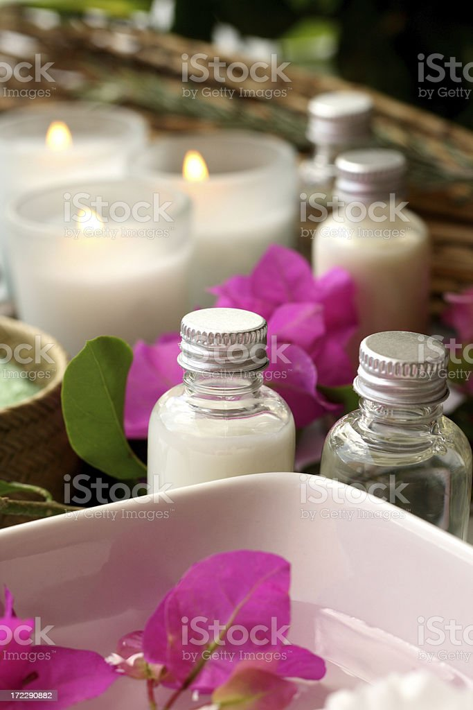 candles, flowers and lotions stock photo