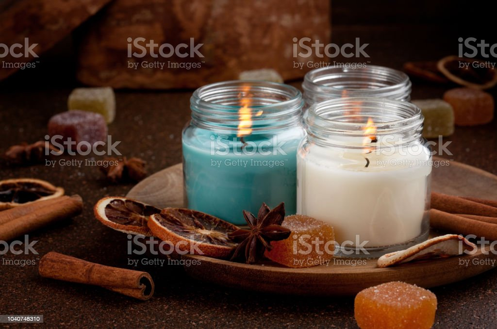 Candles for cold weather.  Cosy winter evening or winter holidays celebration