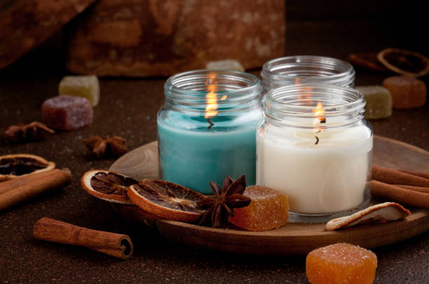 candles for cold weather.  cosy winter evening or winter holidays celebration - candle stock pictures, royalty-free photos & images