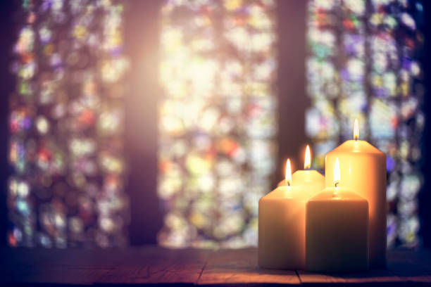 Candles in a church background stock photo