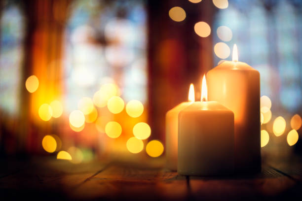 Candles in a church background Candles burning in a church background place of worship stock pictures, royalty-free photos & images