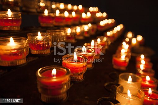 istock Candles in a church 1179412571