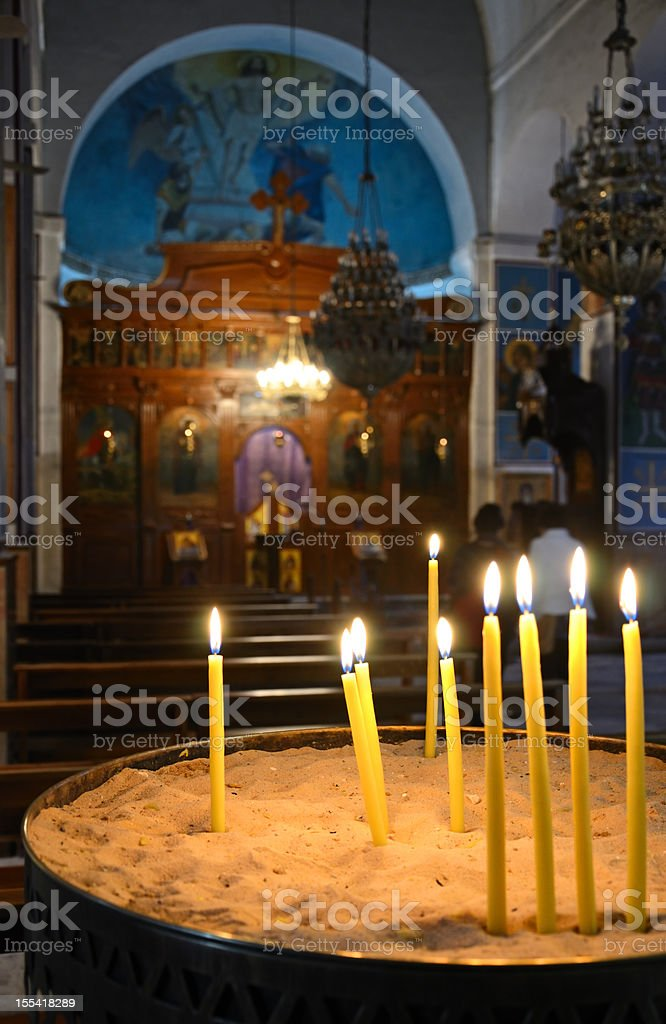 Candles in a church royalty-free stock photo