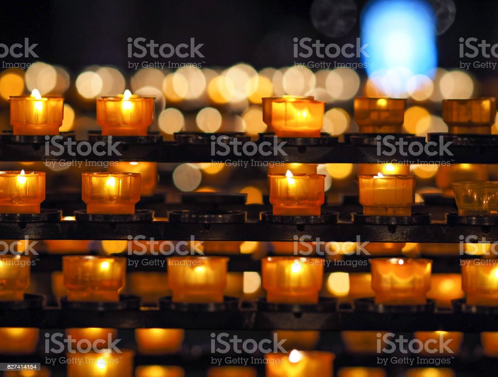 candles in cathedral in Strasbourg stock photo