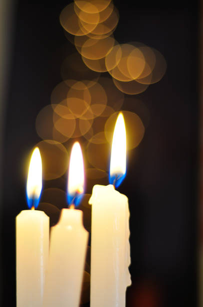 Candles in front of a bokeh background stock photo