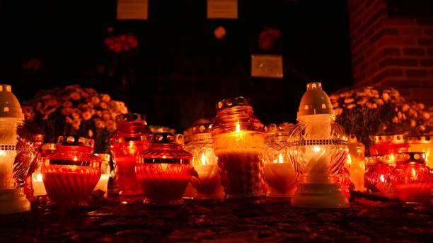 Candles in front of the closed gate of the Powazki municipal cemetery. The government closed the cemeteries at the last minute. stock photo