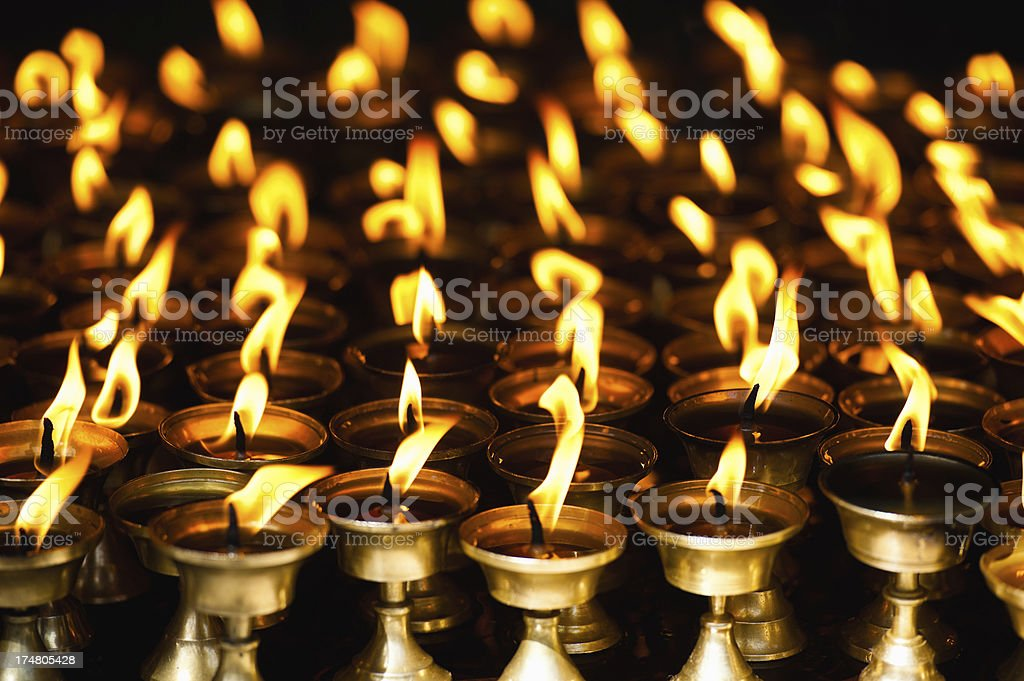 Candles in the dark Shree Boudhanath temple royalty-free stock photo