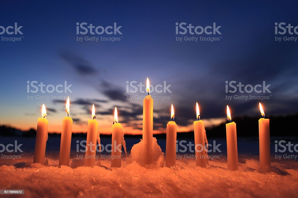 candles in the snow outdoors stock photo