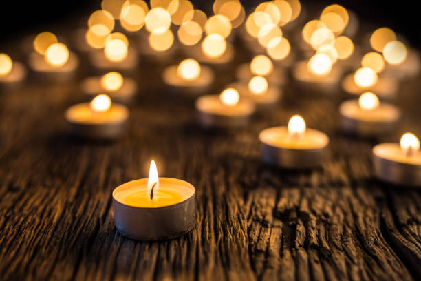 Candles light in advent.. Christmas candles burning at night. Golden light of candle flame stock photo