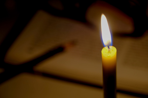 Candles Light With Open Blurred Book Background In The