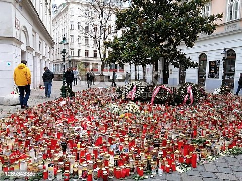 Vienna, Austria-November 12, 2020: people bring flowers and candles in tribute to the victims at the sites of the terrorist attacks in Vienna on 02.11.2020. In memory of those who were killed.