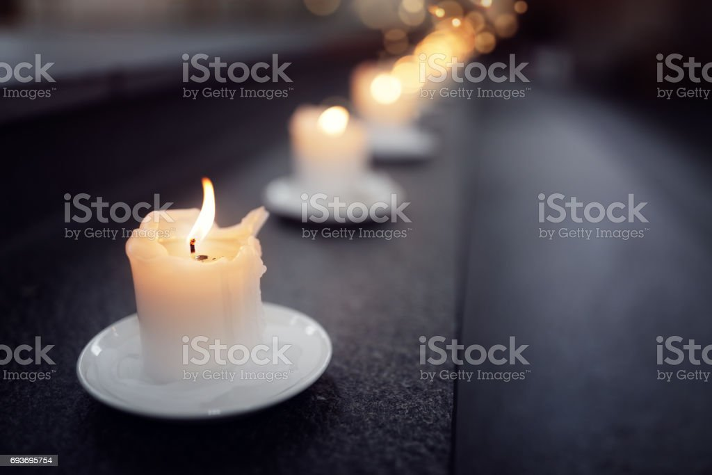Candles on alter steps in a church stock photo