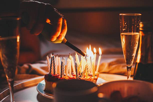 Candles on birthday cake stock photo