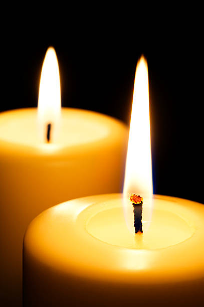 Candles on black background stock photo