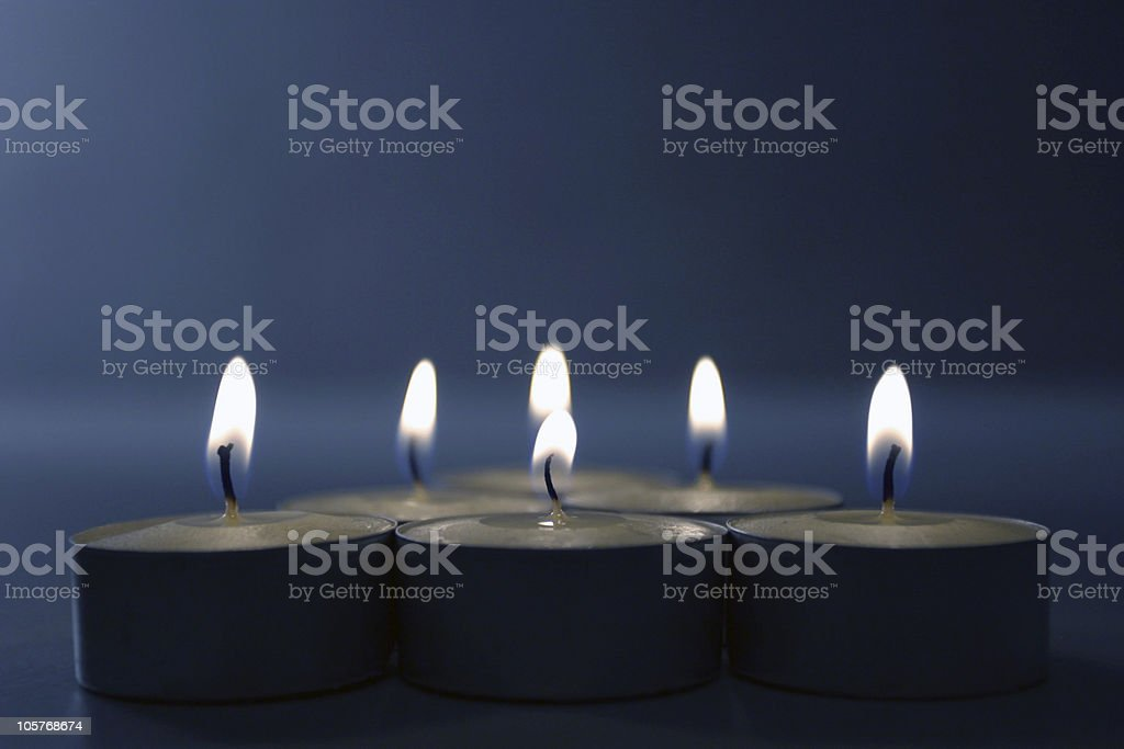 Candles on blue stock photo