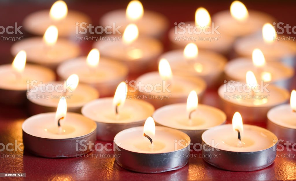 Candles on old retro christmas abstract religion background stock photo