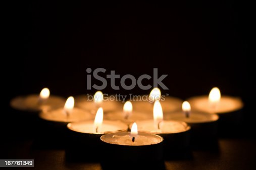 Lighted candles on a black background. Low DOF.
