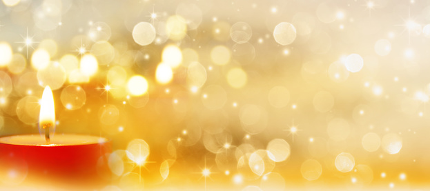 Festive background in gold with a candle